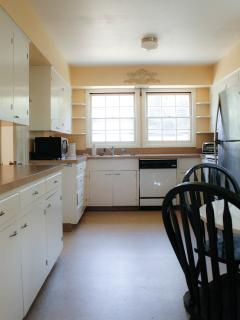 Very large kitchen with microwave, toaster oven, dishwasher, fridge, stove/oven, coffee maker.