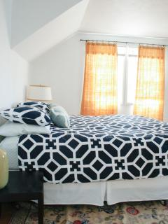 Upstairs bedroom with queen size bed.