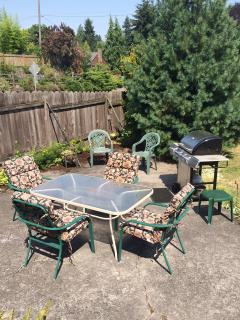 Large backyard with patio, and gas BBQ grill.