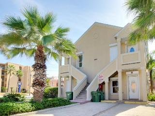 Chic, dog-friendly condo close to beach w/shared pool.