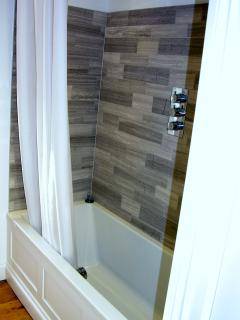 Full size bath and rainflow shower