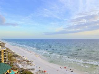 Vacay in this gorgeous, fully-remodeled beachfront condo with private balcony