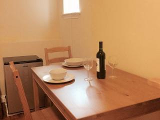 Table. We have a mini-fridge.