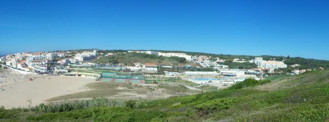 View of Praia Das Macas with the villa on the far right (with chimney, past the lido)