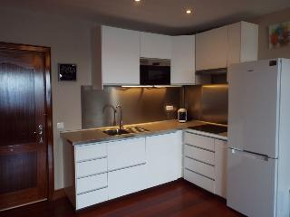 Brand new kitchen with 4 hobs, fridge freezer, microwave, washing machine and coffee maker.