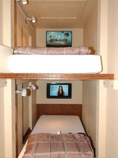 Bedrooms 6a & 6b: Two ea. european style capsule bedrooms each has HD TV, lighting & gel mattress.