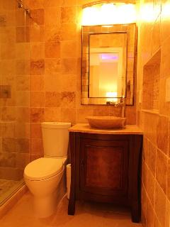 The grotto bath with dimmable lighting.