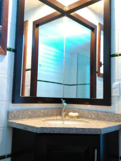 New guest bath vanity with corner mirror.