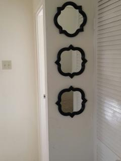 Accent mirror on wall in Living room area.