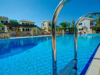 Apt 2-  Spacious apartments with breakfast, pool, tennis court and sea views.