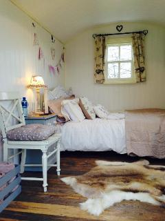 The lovely cosy space in  our bespoke Shepherds Hut