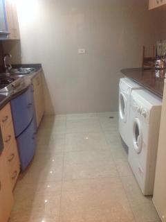 Lavadora y secadora en el apartamento