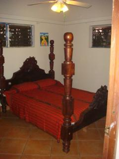 Antique queen sized poster bed with orthopedic mattress