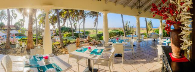 Restaurant Patio with stunning view over the Golf Course, Pool and the Ocean