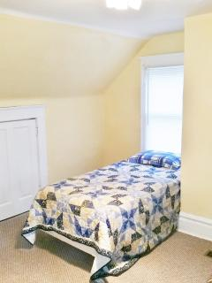Twin size bed.  Room for more if you have a larger group.