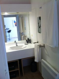 Bright bathrooms with clean towels and powerful hair dryer supplied.