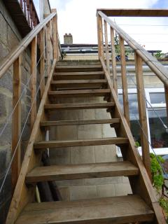 Steep stairs going up to our decking.