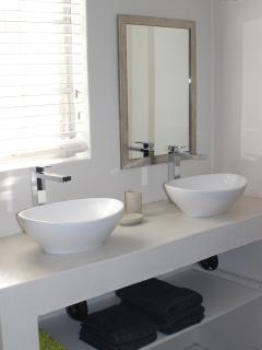 Each bathroom is fitted with double washbasin, shower and toilet