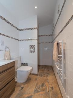 Walk in shower room/bathroom with heated towel rail and underfloor heating
