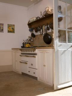 Full rang of kitchen and cooking utensils.
