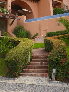 The steps from the covered parking to La Casita.