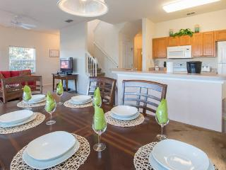 Fully furnished kitchen and dining area with service for 10 guests