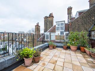 Quintessentially English two bedroom apartment just moments from Harrods with beautiful views and outside terrace., London