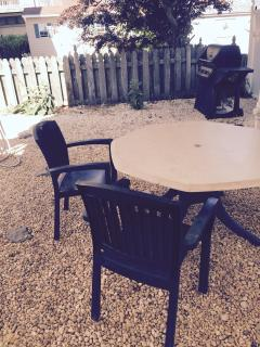 Nice stone patio with patio furniture and gas BBQ grille
