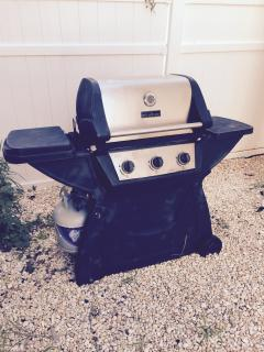 Gas BBQ grille with patio furniture.   Nice