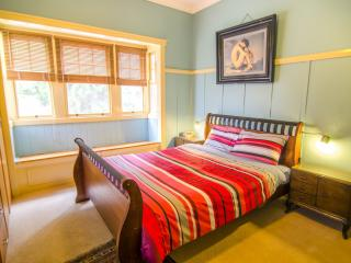 The Master bedroom with Queen bed and bay window.