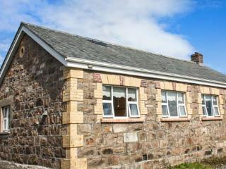 OLD FACTORY HOUSE, detached, stone cottage, open fire, lawned gardens, Carraroe,