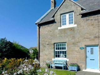 CORNER COTTAGE, end-terrace, woodburning stove, parking, garden, in Amble, Ref