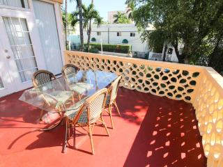 2 bed, one bath, balcony, wifi, walk to beach, parking available