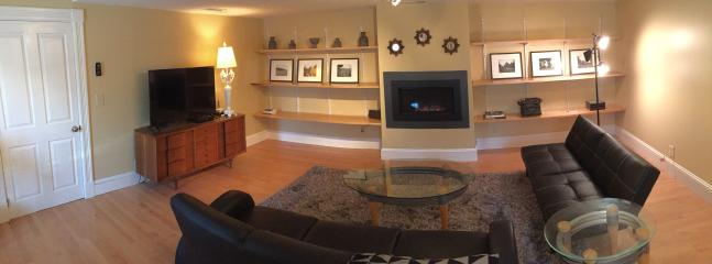 Living room with TV and fireplace. Great for watching a game or movie, or being with friends/family.