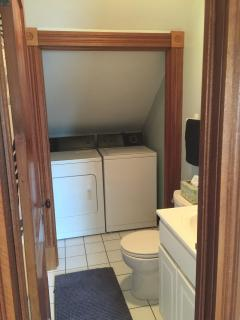 Full bathroom with washer and dryer.
