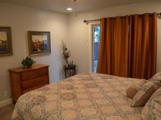 This is the larger bedroom with King bed. Sliding door leads out to yard.