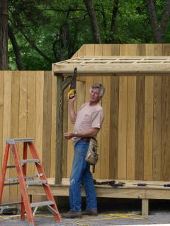 Nate (Owner) building the Privacy Fence (General Store Front).