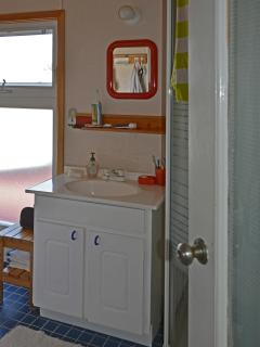 bathroom sink, window  on to the main deck