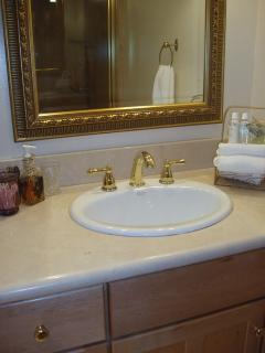 Marble countertops in both bathrooms, soap amenities provided.