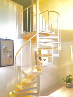 Beautiful spiral staircase going up to loft bedroom.