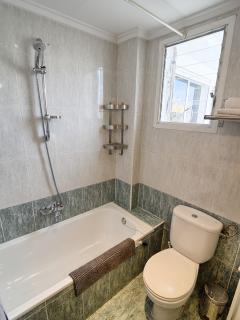 Bathroom with shower over full bath. 'Mains' 'on demand' gas heated hotwater for unlimited hot water