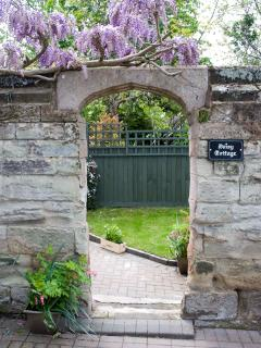 ...the pretty entrance...to a small private garden...