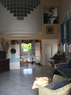 View of kitchen and upstairs bedroom
