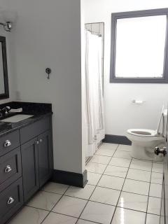 Guest bathroom with two sinks and shower and tub