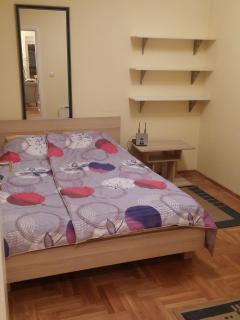 2nd room, bedroom, king bad for  persons, night table.