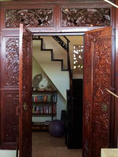 Hand carved wooden doors in bathroom entrance