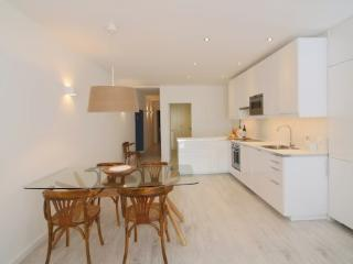 Dining area and fully equipped kitchen.