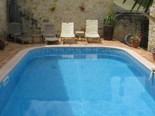 Patio and shared heated swimming pool