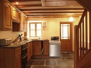 Kitchen with dishwasher, oven, fridge, freezer & washing machine.