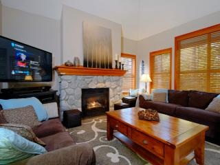 Cozy living room has a large flat screen TV with PVR, Bluetooth SoundBar, DVD player & DVD library.